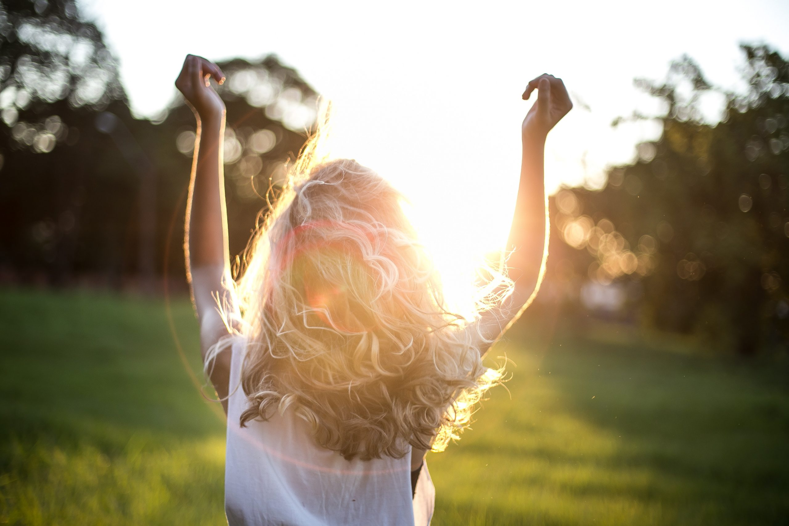 Curly blonde haired woman in the sun